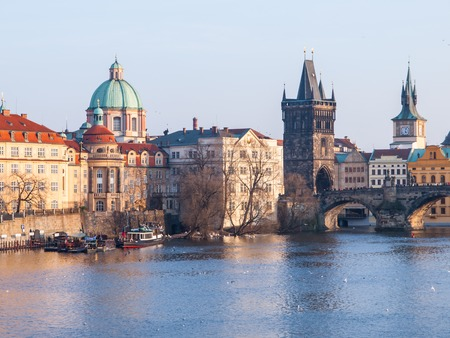 st charles: View of Charles Bridge with Old Town Bridge Tower and Church of St Francis of Assisi, Prague, Czech Republic Stock Photo