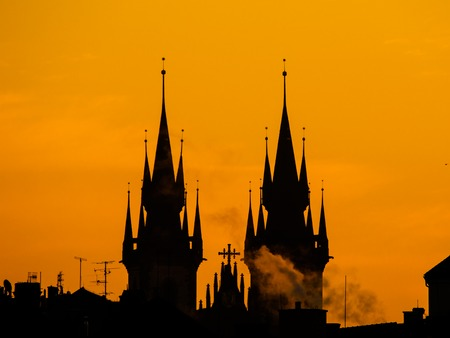 Silhouette of two towers of Church of Our Lady before Tyn in morning Prague, Czech Republic