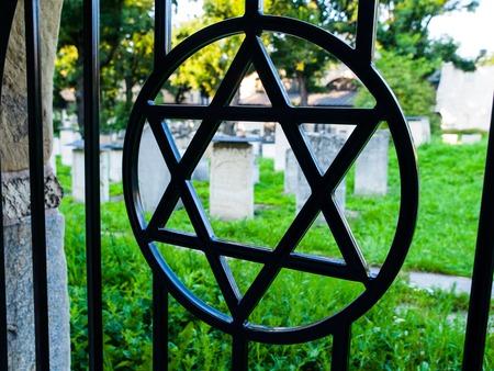 jewish star: Iron gate with David star at jewish cemetery, Krakow, Poland