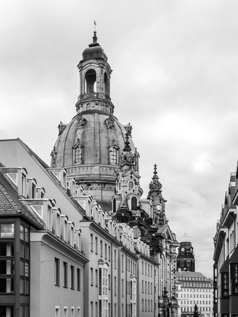 frauenkirche: Dome of Dresden Frauenkirche behind buildings of Old Town, Germany. Black and white image.
