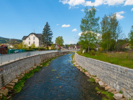 river bed: Reconstructed river bed and banks after flood. Part of small river with new rock banks reducing flood risk, Chrastava, Czech Republic Stock Photo