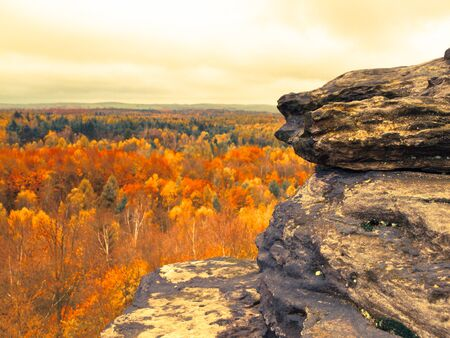 czech switzerland: Panoramic view of sandstone rock formation in the middle of colorful autumn forest. Dramatic evening view. Tisa Rocks, aka Tiske Walls, Czech-Saxon Switzerland, Czech Republic Archivio Fotografico