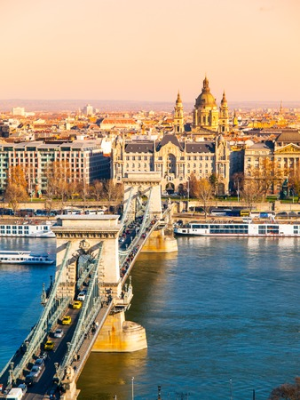 stephen: Famous Chain Bridge over Danube River and Saint Stephens Basilica view from Buda Castle on sunny autumn day in Budapest, capital city of Hungary, Europe. UNESCO World Heritage Site