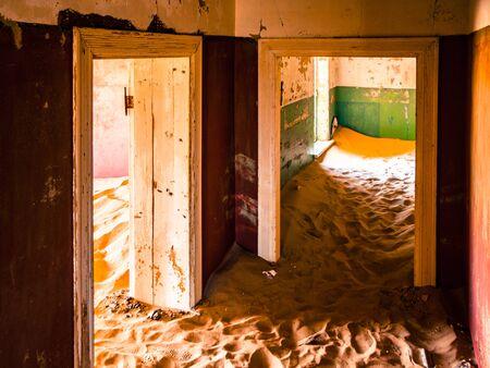 kolmannskuppe: Sand dunes in abandoned house of Kolmanskop ghost town in Namibia, Africa.
