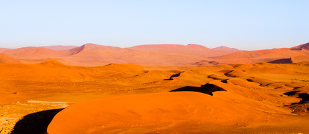 Red dunes of Namib Desert near Sossusvlei, aka Sossus Vlei, Namib-Naukluft National Park, Namibia, Africa. Stock Photo