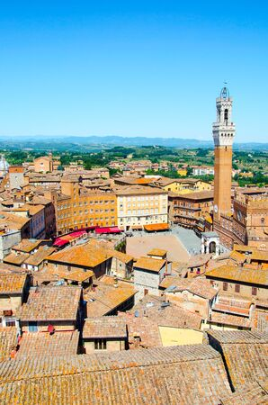 The Torre del Mangia, tower located in the ancient medieval historical city centre at Piazza del Campoin in Siena, Tuscany region, Italy Stock Photo