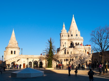 halaszbastya: Typical light stone rounded fairy tale towers of Fishermans Bastion, aka Halaszbastya, on a terrace in neo-Gothic and neo-Romanesque architectural style. Lookout turrets are situated on a Buda bank side of Danube River in Budapest, capital city of Hungary