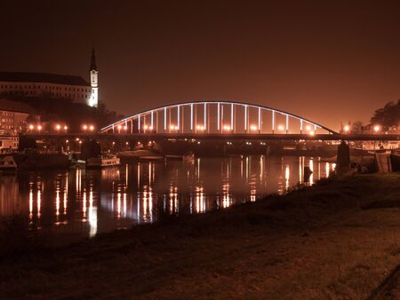 Night view of Decin Castle and Tyrs Bridge over Elbe River, Decin, Czech Republic, Europe