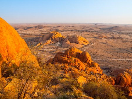 Landscape around Spitzkoppe, aka Spitzkop, with massive granite rock formations, Namib Desert in Namibia, Africa.