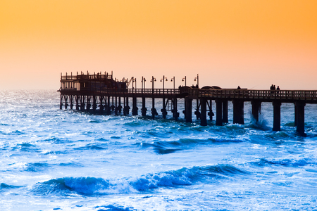 Coastal pier at evening time. Atlantic Ocean view in Swakopmund, Namibia, Africa.