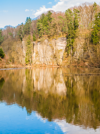 Sandstone rock formations reflected in the water. Plakanek Valley in Bohemian Paradise, aka Cesky Raj, Czech Republic, Europe. Stock Photo
