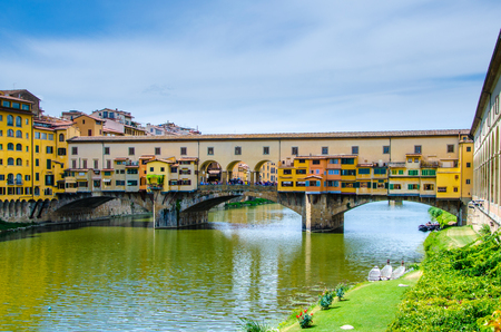 Ponte Vecchio, Old Bridge, medieval stone arch bridge over the Arno River and with many small shops along it, Florence, Tuscany, Italy, Europe.