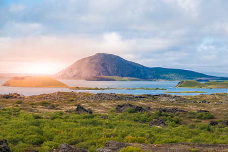 crater lake: Sunset time in volcanic landscape at Myvatn Lake, aka Lake of mosquitos, northern Iceland. Stock Photo