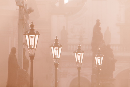 most popular: Street lamps on Charles bridge illuminated by sun in the morning, Old Town, Prague, Czech Republic.