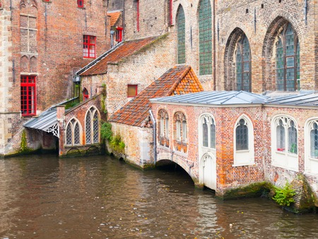 Water canal at Old Saint Johns Hospital, Bruges, Belgium. Stock Photo