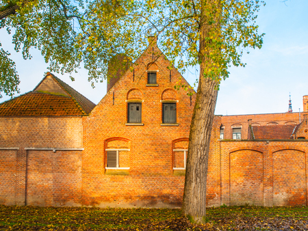 Historical brick building of Minnewater hospital in Bruges, Belgium. Stock Photo