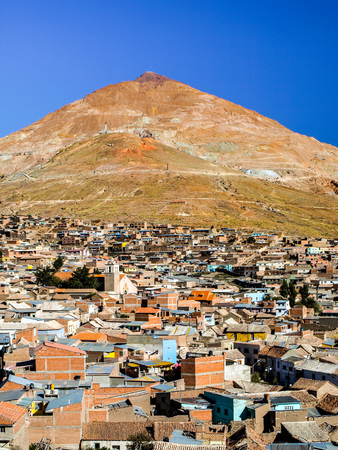 bolivian: Cerro Rico and rooftops of Potosi city centre, Bolivia, South America. Stock Photo