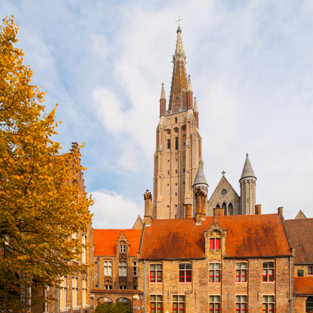Gothic tower of Church of Our Lady in Bruges is the second tallest brickwork tower in the world. Фото со стока