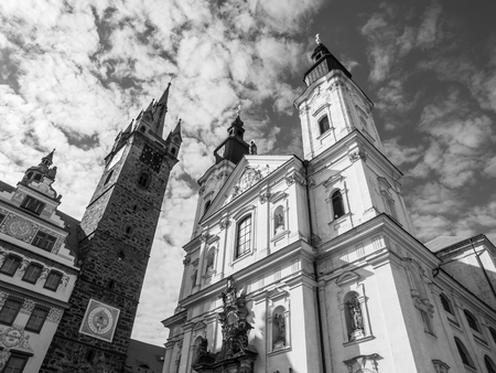 gildhall: Black Tower and The Church of Virgin Marys Immaculate Conception and St. Ignatus in Klatovy, Czech Republic. Black and white image.
