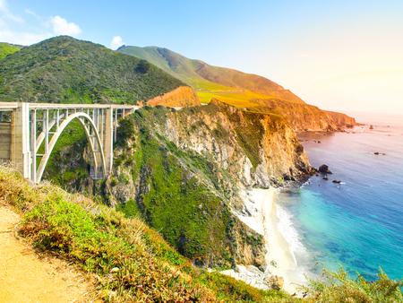 curve road: Concrete arch of Bixby Creek Bridge on Pacific rocky coast, Big Sur, California, USA.