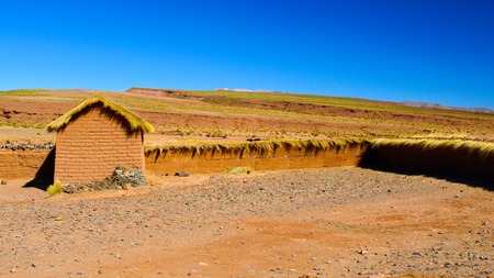 Landscape of southern Altiplano with clay brick wall and small hut, Andes, Bolivia. Stock Photo