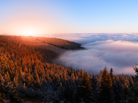 inversion: Mountain landscape at sunset time. Freezy evening and weather inversion, Giant Mountains, aka Krkonose, Czech Republic. Stock Photo