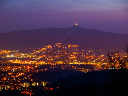 Evening view of illuminated Liberec city and Jested Mountain. Night scene. Stock Photo