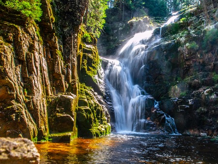 Kamienczyk waterfall near SzklarskaPoreba in Giant mountains or Karkonosze, Poland. Long time exposure. 版權商用圖片