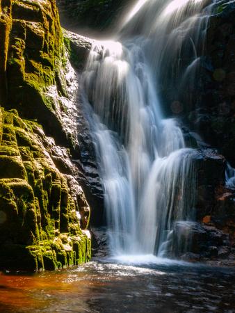 Kamienczyk waterfall near SzklarskaPoreba in Giant mountains or Karkonosze, Poland. Long time exposure. Stock Photo