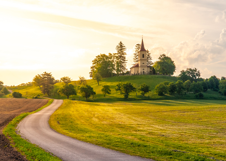 Small church in the middle of lush green spring landscape on sunny day. St. Peter and Pauls church at Bysicky near Lazne Belohrad, Czech Republic. Reklamní fotografie