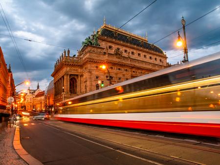 Evening at National Theater and blurred tram on the bridge, Prague, Czech Republic. Long exposure shot.