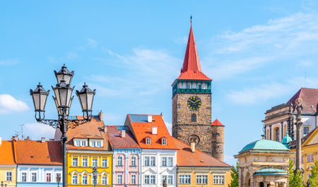 Colorful renaissance houses and Valdice Gate at Wallenstein Square in Jicin, Czech Republic.