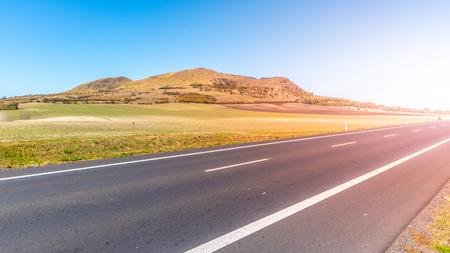 Rana Mountain and asphalt road near Louny in Central Bohemian Highlands on sunny summer day, Czech Republic. Reklamní fotografie