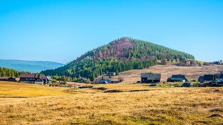 Bukovec Mountain above Jizerka Village in Jizera Mountains, Czech Republic. Clear sunny day.