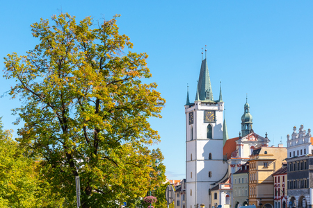 White tower of All Saints Church near main Peace square, Litomerice, Czech Republic.