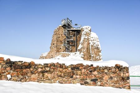 Ruins of medieval castle Lichnice near Tremosnice, Czech Republic. Sunny snowy winter day. Stock Photo