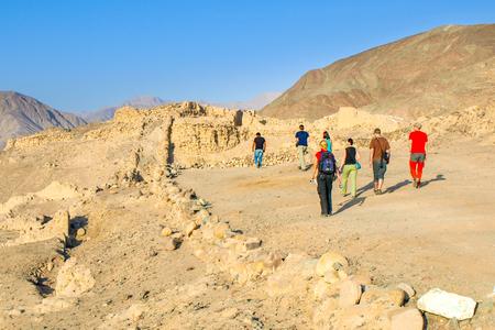 Tourists in Los Paredones - Incan ruins near Nasca, Peru, South America.