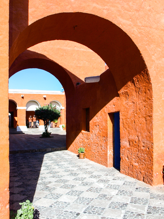 Red facade streets of Santa Catalina Monastery in Arequipa, Peru, South America.