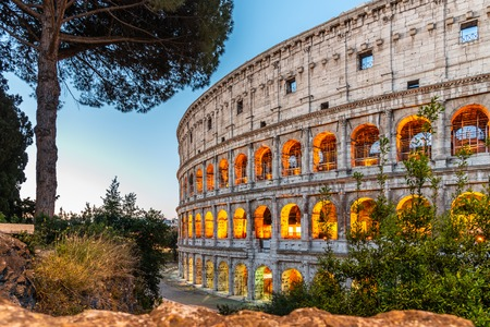 Colosseum, or Coliseum. Illuminated huge Roman amphitheatre early in the morning, Rome, Italy.