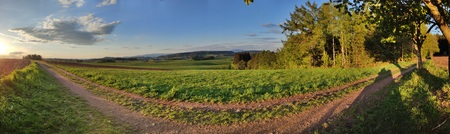 Green hilly landscape with Giant Mountains, Czech: Krkonose, on skyline, Czech Republic. Panoramic shot.