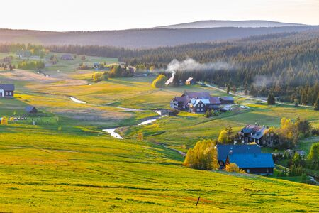 Jizerka village at sunset time. View from Bukovec Mountain, Jizera Mountains, Czech Republic.