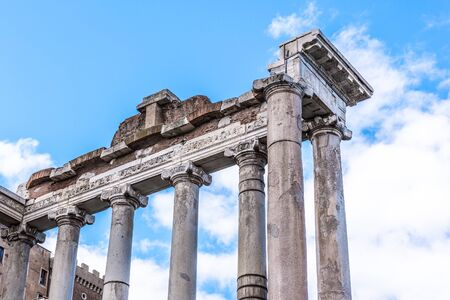 Temple of Saturn - ruins with old historical columns. Roman Forum archeological site, Rome, Italy.