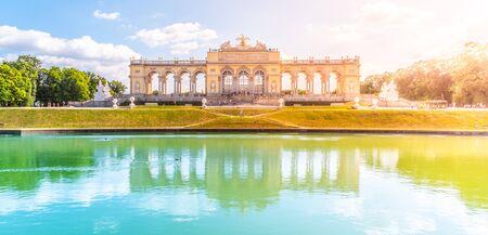 VIENNA, AUSTRIA - 23 JULY, 2019: The Gloriette in Schonbrunn Palace Gardens, Vienna, Austria. Front view and water reflection.