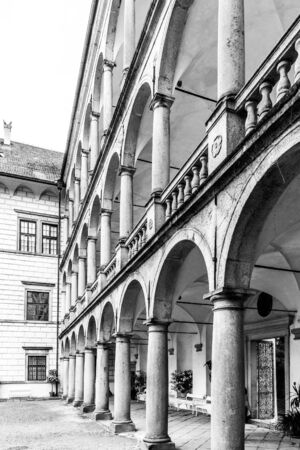 JINDRICHUV HRADEC, CZECH REPUBLIC - 27 JULY, 2019: Great arcades - white renaissance archs on Third Courtyard of Jindrichuv Hradec Castle in Jindrichuv Hradec, Czech Republic. Black and white image.