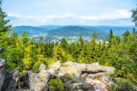 Scenic view of Tanvaldsky Spicak from rocky summit of Muchov Hill, Jizera Mountains, Czech Republic.