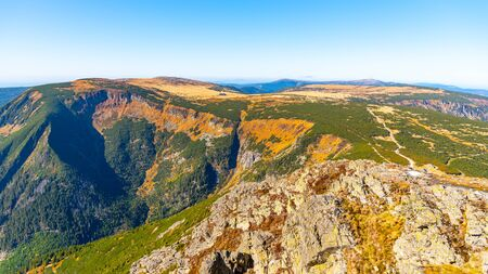 Studnicni Mountain and Giant Valley, Czech: Obri dul, on autumn sunny day in Krkonose - Giant Mountains, Czech Republic. View from lookout point on Snezka Mountain.