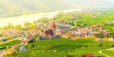 Sunny day in Wachau Valley. Landscape of vineyards and Danube River at Weissenkirchen, Austria.