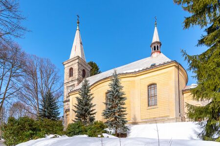 Church of Saint Peter and Paul in Tanvald on sunny winter day, Czech Republic.