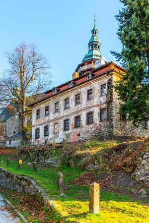 Old deanery and St George Church in Horni Slavkov. Sunny autumn day. Czech Republic.