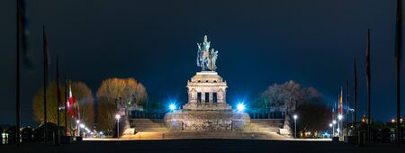 Night view of monumental equestrian statue of William I, the first German Emperor.,at German Corner, German: Deutsches Eck. Confluence of rivers Mosel and Rhine, Germany.